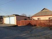 Продається будинок , гараж на два авто , сарай 2 поверхи , на земній ділянці в 7 соток Тальное