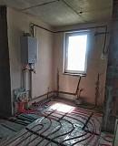 Новая квартира с темя спальнями и частичным ремонтом в Счастливом Борисполь