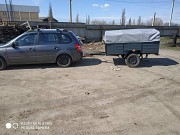 Купить новый автомобильный прицеп 200х120х35 на рессорах Волга (лист 8мм) с тентом в подарок! Коростень